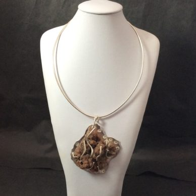 Botoidal stone set with Sterling silver on a Sterling wire neckpiece.